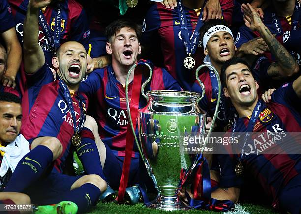 Javier Mascherano Lionel MessiNeymar Jr and Luis Suarez pose with the trophy during the UEFA Champions League Final between Barcelona and Juventus at...