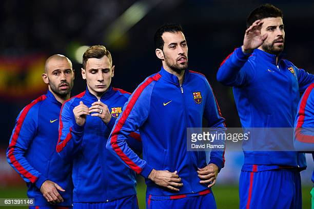Javier Mascherano Lucas Digne Sergio Busquets and Gerard Pique of FC Barcelona look on prior to the kickoff of the La Liga match between Villarreal...