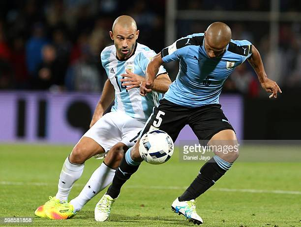 Javier Mascherano of Argentina and Carlos Sanchez of Uruguay fight for the ball during a match between Argentina and Uruguay as part of FIFA 2018...