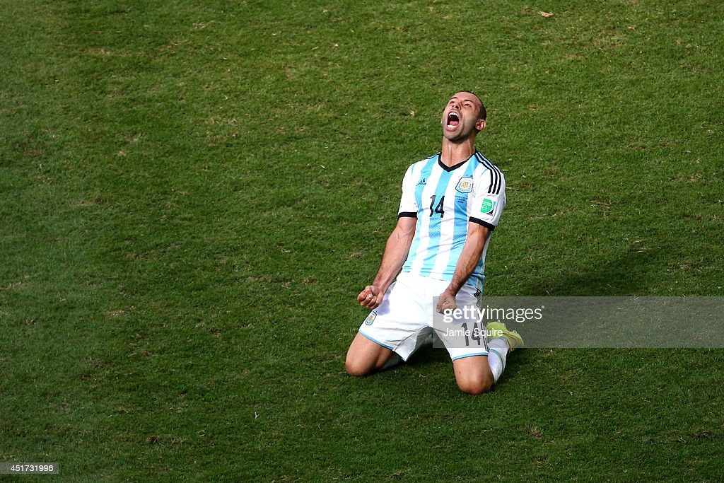 <a gi-track='captionPersonalityLinkClicked' href=/galleries/search?phrase=Javier+Mascherano&family=editorial&specificpeople=490876 ng-click='$event.stopPropagation()'>Javier Mascherano</a> of Argentina celebrates after defeating Belgium 1-0 during the 2014 FIFA World Cup Brazil Quarter Final match between Argentina and Belgium at Estadio Nacional on July 5, 2014 in Brasilia, Brazil.