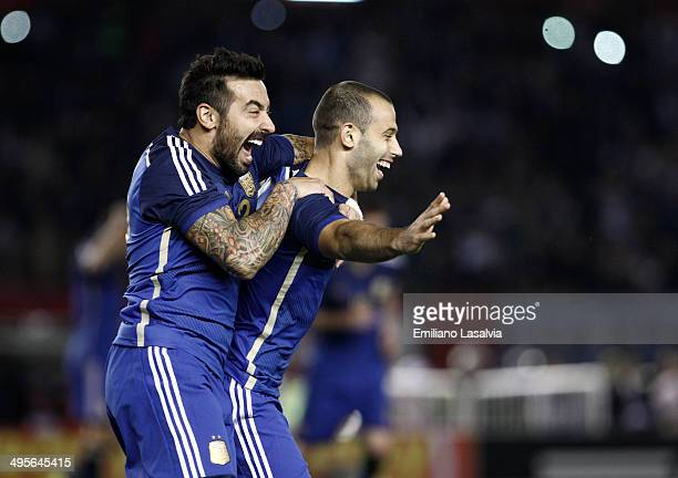 Javier Mascherano of Argentina celebrates with Ezequiel Lavezzi after scoring his team's second goal during a FIFA friendly match between Argentina...