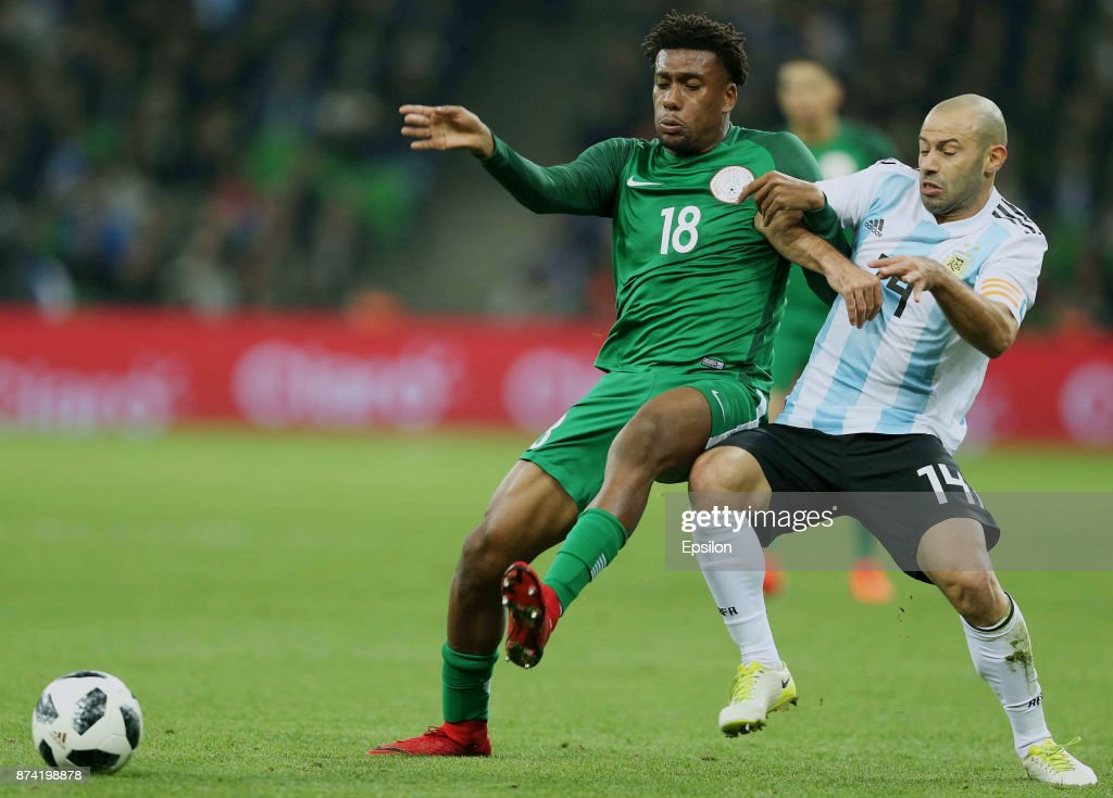 Javier Mascherano of Argentina fights for the ball with Alex Iwobi of Nigeria during an international friendly match between Argentina and Nigeria at Krasnodar Stadium on November 14, 2017 in Krasnodar, Russia.