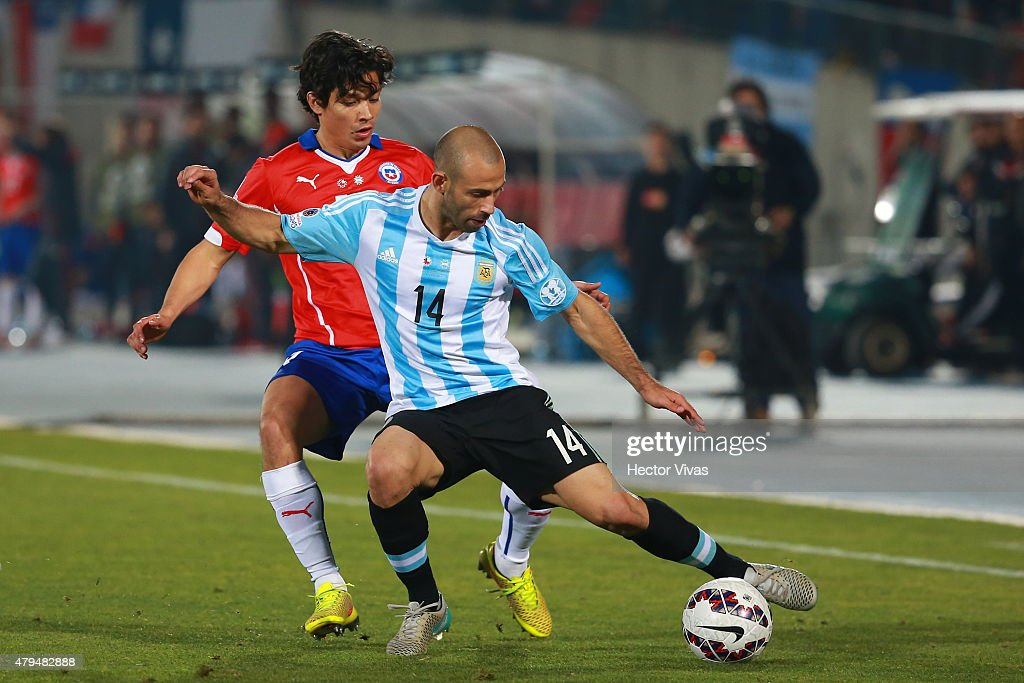 Javier Mascherano of Argentina fights for the ball with Matias Fernandez of Chile during the 2015 Copa America Chile Final match between Chile and...