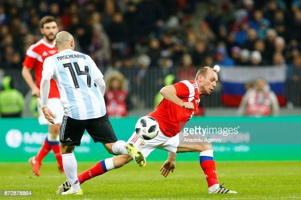 Javier Mascherano of Argentina in action against Denis Glushakov of Russia during the international friendly match between Russia and Argentina at...