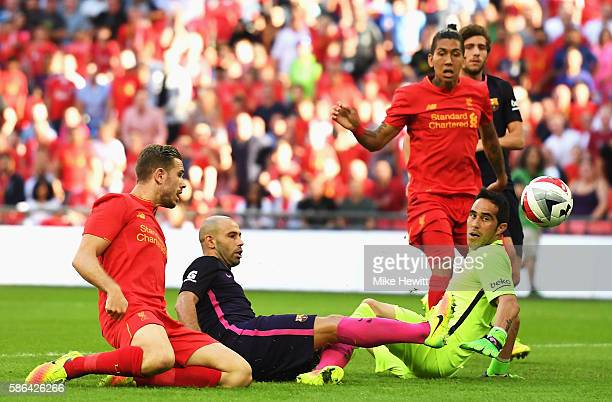 Javier Mascherano of Barcelona scores an own goal for Liverpool's second goal during the International Champions Cup match between Liverpool and...