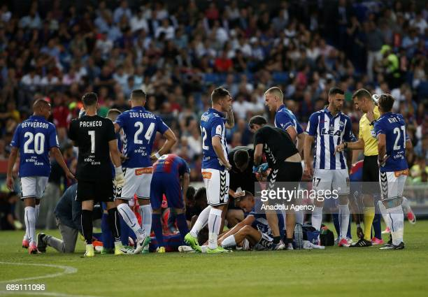 Javier Mascherano of FC Barcelona and Marcos Llorente of Deportivo Alaves get injured during the Copa Del Rey Final between FC Barcelona and...