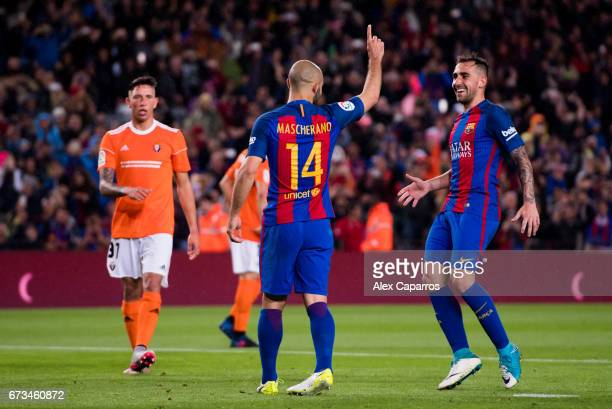 Javier Mascherano of FC Barcelona celebrates with his teammate Paco Alcacer after scoring his team's sisth goal during the La Liga match between FC...