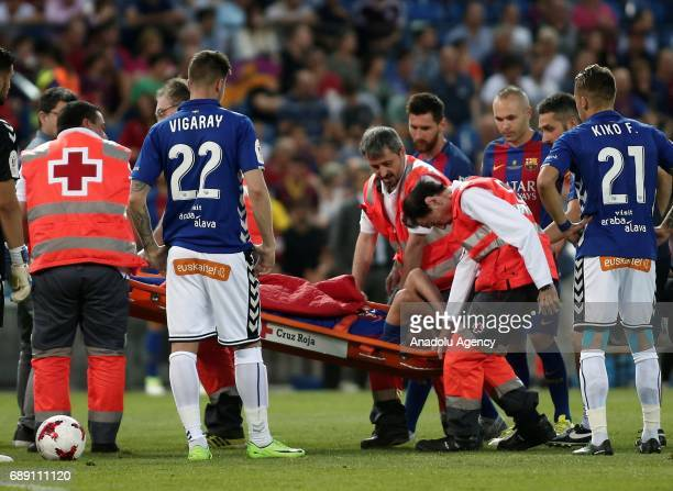 Javier Mascherano of FC Barcelona gets injured during the Copa Del Rey Final between FC Barcelona and Deportivo Alaves at Vicente Calderon Stadium on...