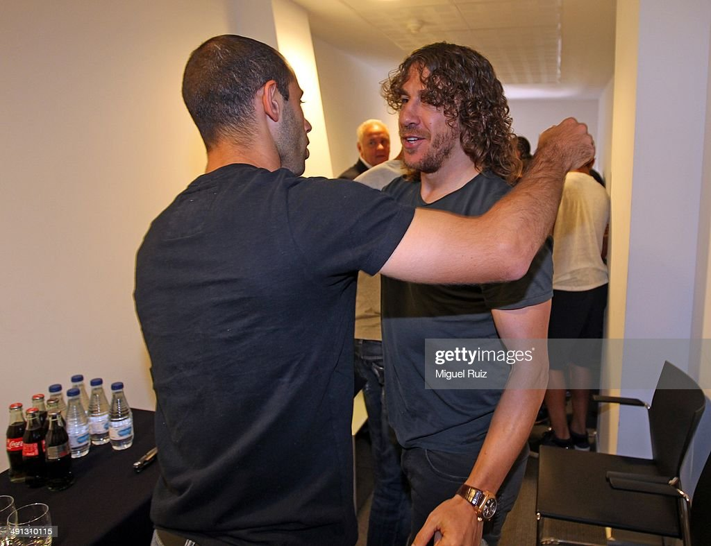 <a gi-track='captionPersonalityLinkClicked' href=/galleries/search?phrase=Javier+Mascherano&family=editorial&specificpeople=490876 ng-click='$event.stopPropagation()'>Javier Mascherano</a> of FC Barcelona greets his team-mate <a gi-track='captionPersonalityLinkClicked' href=/galleries/search?phrase=Carles+Puyol&family=editorial&specificpeople=211383 ng-click='$event.stopPropagation()'>Carles Puyol</a> (R) during the farewell press conference as Puyol leaves FC Barcelona at the Auditorium 1899 on May 15, 2014 in Barcelona, Spain.