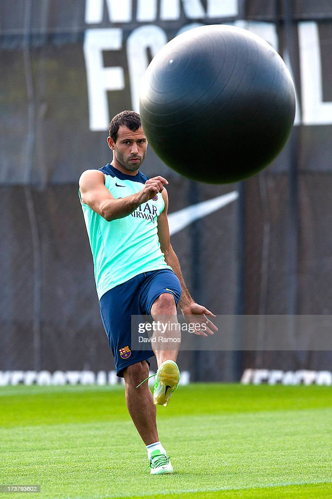 <a gi-track='captionPersonalityLinkClicked' href=/galleries/search?phrase=Javier+Mascherano&family=editorial&specificpeople=490876 ng-click='$event.stopPropagation()'>Javier Mascherano</a> of FC Barcelona kicks a training ball during a training session at the Sant Joan Despi sport complex on July 18, 2013 in Barcelona, Spain.