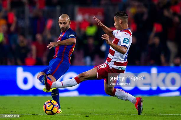 Javier Mascherano of FC Barcelona plays the ball past Andreas Pereira of Granada CF during the La Liga match between FC Barcelona and Granada CF at...