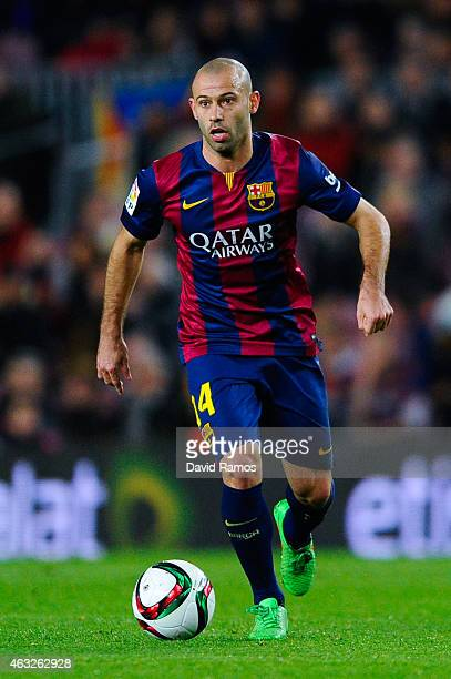 Javier Mascherano of FC Barcelona runs with the ball during the Copa del Rey SemiFinal first leg match between FC Barcelona and Villarreal CF at Camp...