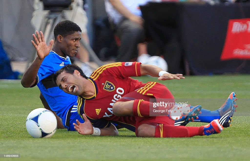 Javier Morales of Real Salt Lake grabs his ankle after he was taken down by Khari Stephenson of the San Jose Earthquakes during the first half of an...