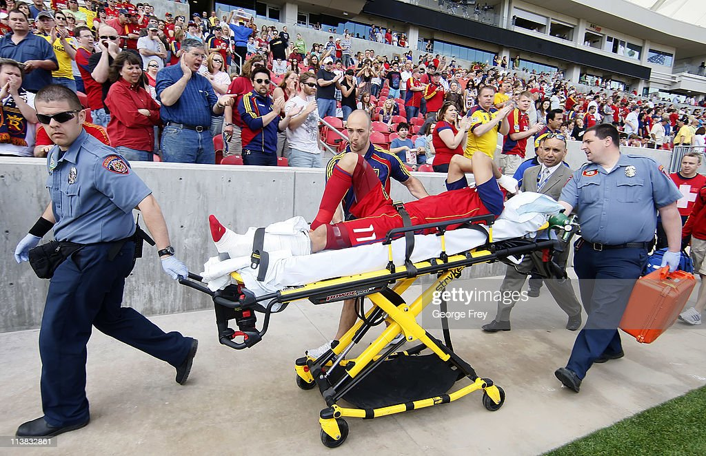 Javier Morales of Real Salt Lake is cheered as he is taken off the field after he was taken down by Marcos Mondaini of Chivas USA during the first...