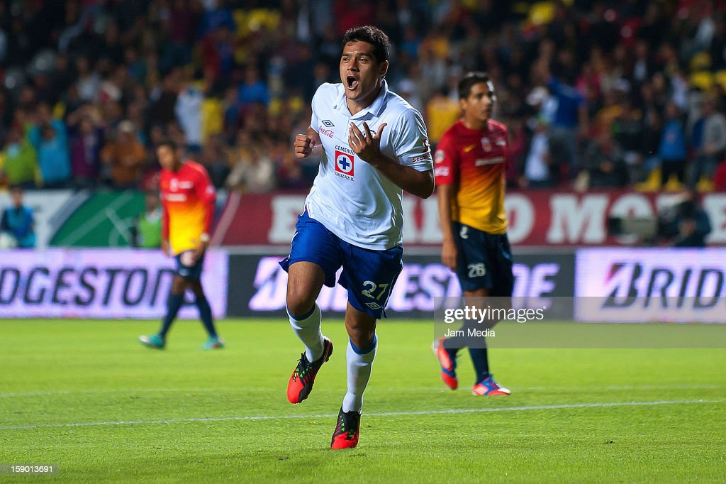 <a gi-track='captionPersonalityLinkClicked' href=/galleries/search?phrase=Javier+Orozco&family=editorial&specificpeople=5505680 ng-click='$event.stopPropagation()'>Javier Orozco</a> of Cruz Azul celebrates a scored goal during a match against Morelia as part of the Clausura 2013 Liga MX at Morelos Stadium on january 04, 2013 in Morelia, Mexico.