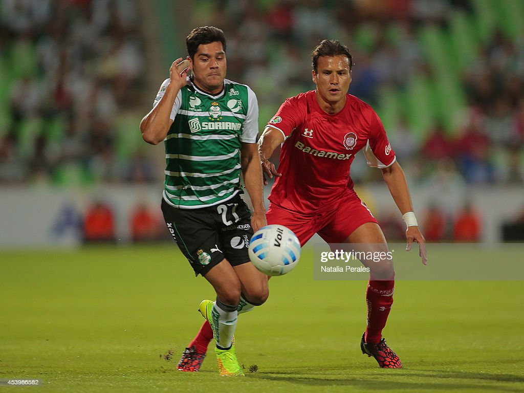 Javier Orozco of Santos (L) fights for the ball with Aaron Galindo of Toluca (R) during a match between Santos Laguna and Toluca as part of 6th round Apertura 2014 Liga MX at Corona Stadium on August 22, 2014 in Torreon, Mexico.