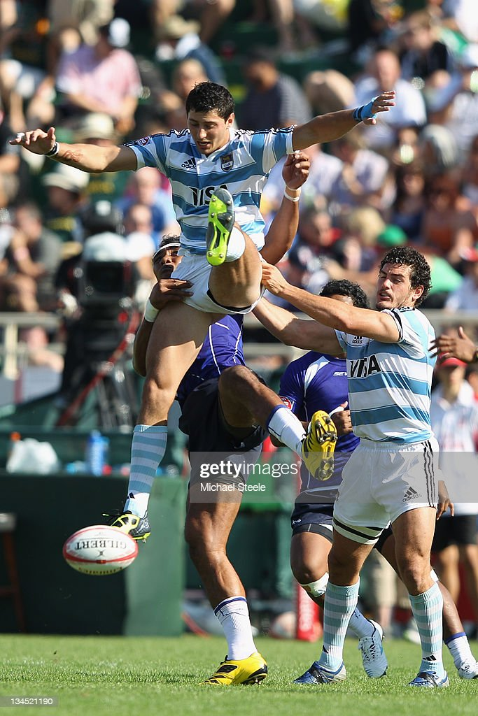 Javier Ortega Desio of Argentina is airborne from a challenge by <a gi-track='captionPersonalityLinkClicked' href=/galleries/search?phrase=Lolo+Lui&family=editorial&specificpeople=577160 ng-click='$event.stopPropagation()'>Lolo Lui</a> of Samoa during the match between Argentina and Samoa on Day Two of the IRB Dubai Sevens at the Sevens Stadium on December 2, 2011 in Dubai, United Arab Emirates.