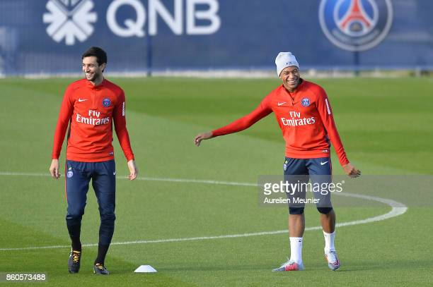 Javier Pastore and Kylian Mbappe of Paris SaintGermain warm up before a Paris SaintGermain training session at Centre Ooredoo on October 12 2017 in...