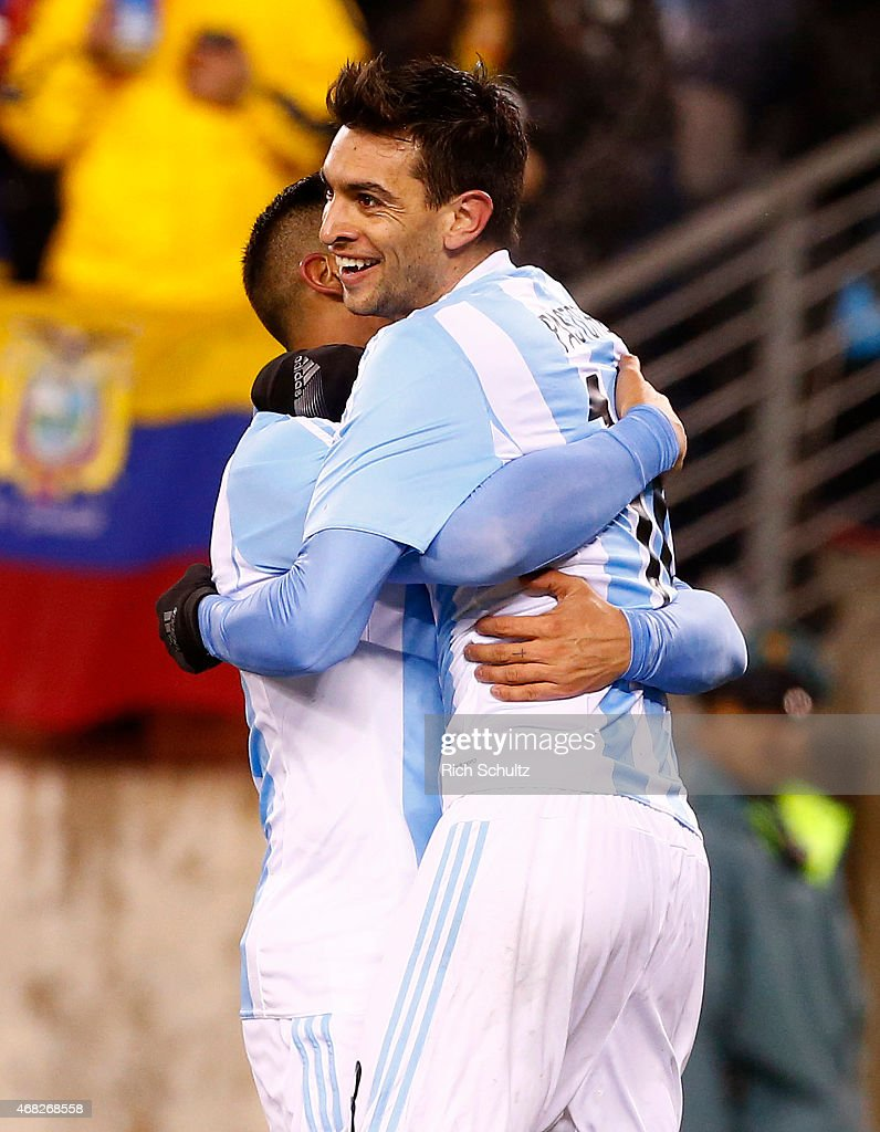 Javier Pastore #18 of Argentina celebrates with Marcos Rojo #16 after scoring his team's second goal during an international friendly match between Argentina and Ecuador at Metlife Stadium on March 31, 2015 in East Rutherford, United States. Argentina defeated Ecuador 2-1.