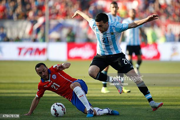 Javier Pastore of Argentina fights for the ball with Marcelo Diaz of Chile during the 2015 Copa America Chile Final match between Chile and Argentina...