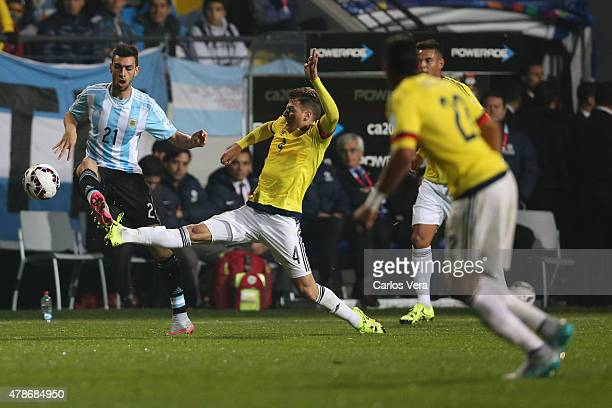 Javier Pastore of Argentina fights for the ball with Santiago Arias of Colombia during the 2015 Copa America Chile quarter final match between...