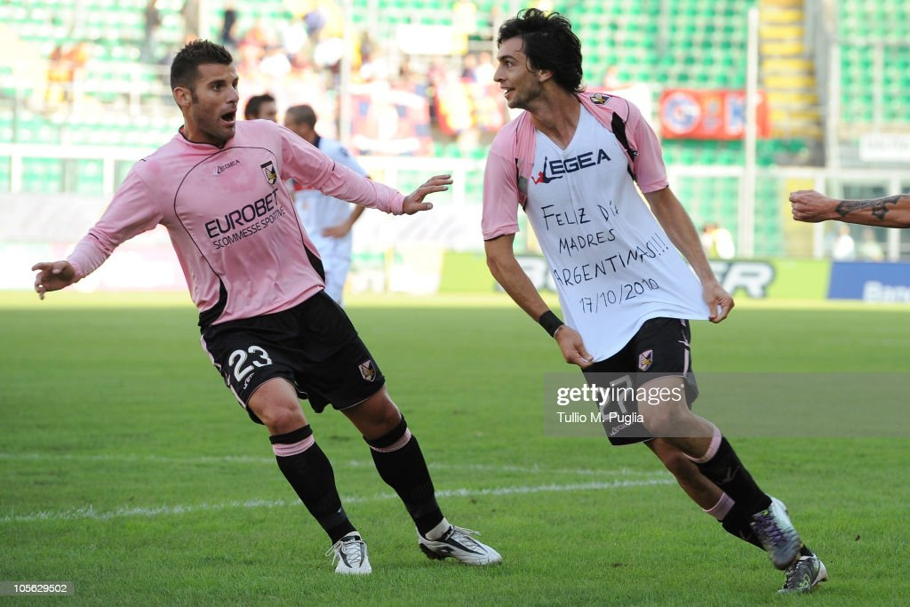 <a gi-track='captionPersonalityLinkClicked' href=/galleries/search?phrase=Javier+Pastore&family=editorial&specificpeople=5857872 ng-click='$event.stopPropagation()'>Javier Pastore</a> (R) of Palermo celebrates the opening goal with his team mate <a gi-track='captionPersonalityLinkClicked' href=/galleries/search?phrase=Antonio+Nocerino&family=editorial&specificpeople=675969 ng-click='$event.stopPropagation()'>Antonio Nocerino</a> (L) during the Serie A match between US Citta di Palermo and Bologna FC at Stadio Renzo Barbera on October 17, 2010 in Palermo, Italy.