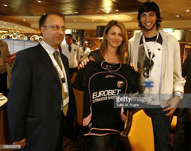 Javier Pastore of Palermo poses with guests on the ship for the opening tournaments of the Mediterranean Cruise Eurobetpoker on October 26 2010 in...