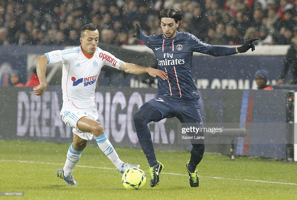 <a gi-track='captionPersonalityLinkClicked' href=/galleries/search?phrase=Javier+Pastore&family=editorial&specificpeople=5857872 ng-click='$event.stopPropagation()'>Javier Pastore</a> of Paris Saint-Germain FC and <a gi-track='captionPersonalityLinkClicked' href=/galleries/search?phrase=Foued+Kadir&family=editorial&specificpeople=4520875 ng-click='$event.stopPropagation()'>Foued Kadir</a> of Marseille Olympic during the French League 1 between Paris Saint-Germain FC and Marseille Olympic OM, at Parc des Princes on February 24, 2013 in Paris, France.