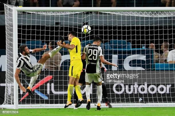 Javier Pastore of Paris SaintGermain scores a goal on Carlo Pinsoglio of Juventus during their International Champions Cup 2017 match at Hard Rock...