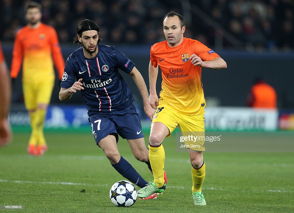Javier Pastore of PSG and Andres Iniesta of Barcelona in action during the Champions League's quarter-final between Paris Saint-Germain FC and FC Barcelona at the Parc des Princes stadium on April 2, 2013 in Paris France.