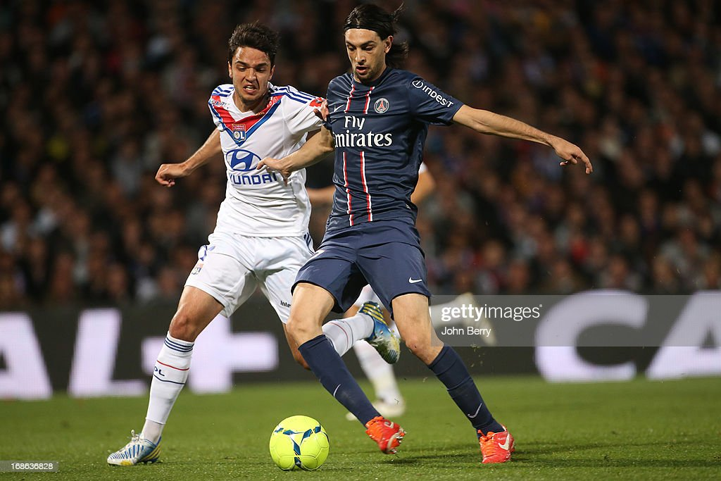 <a gi-track='captionPersonalityLinkClicked' href=/galleries/search?phrase=Javier+Pastore&family=editorial&specificpeople=5857872 ng-click='$event.stopPropagation()'>Javier Pastore</a> of PSG and Clement Grenier of Lyon (L) in action during the Ligue 1 match between Olympique Lyonnais, OL, and Paris Saint-Germain FC, PSG, at the Stade Gerland on May 12, 2013 in Lyon, France.