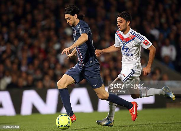 Javier Pastore of PSG and Clement Grenier of Lyon in action during the Ligue 1 match between Olympique Lyonnais OL and Paris SaintGermain FC PSG at...