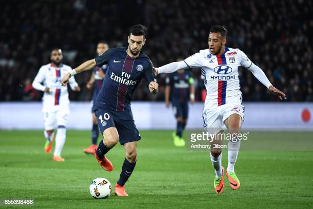 Javier Pastore of PSG and Corentin Tolisso of Lyon during the French Ligue 1 match between Paris Saint Germain and Lyon at Parc des Princes on March...