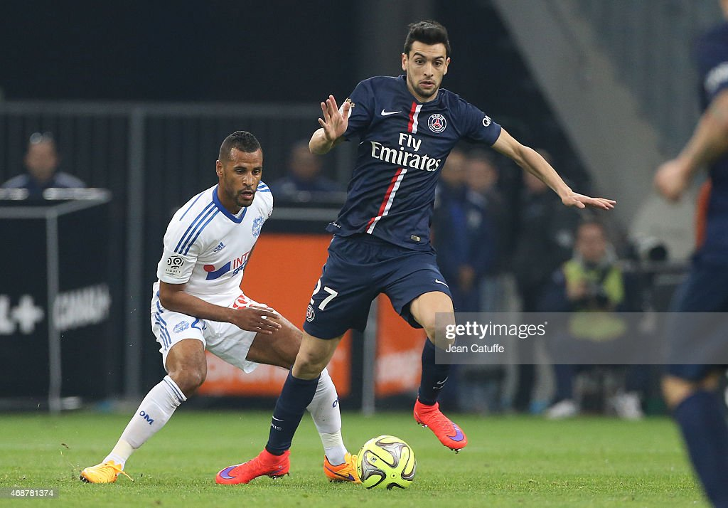 <a gi-track='captionPersonalityLinkClicked' href=/galleries/search?phrase=Javier+Pastore&family=editorial&specificpeople=5857872 ng-click='$event.stopPropagation()'>Javier Pastore</a> of PSG and Jacques-<a gi-track='captionPersonalityLinkClicked' href=/galleries/search?phrase=Alaixys+Romao&family=editorial&specificpeople=554325 ng-click='$event.stopPropagation()'>Alaixys Romao</a> of OM (left) in action during the French Ligue 1 match between Olympique de Marseille (OM) and Paris Saint-Germain (PSG) at New Stade Velodrome on April 5, 2015 in Marseille, France.