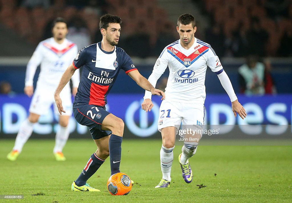 <a gi-track='captionPersonalityLinkClicked' href=/galleries/search?phrase=Javier+Pastore&family=editorial&specificpeople=5857872 ng-click='$event.stopPropagation()'>Javier Pastore</a> of PSG and <a gi-track='captionPersonalityLinkClicked' href=/galleries/search?phrase=Maxime+Gonalons&family=editorial&specificpeople=6256905 ng-click='$event.stopPropagation()'>Maxime Gonalons</a> of Lyon in action during the French Ligue 1 match between Paris Saint-Germain FC and Olympique Lyonnais at the Parc des Princes stadium on December 1, 2013 in Paris, France.