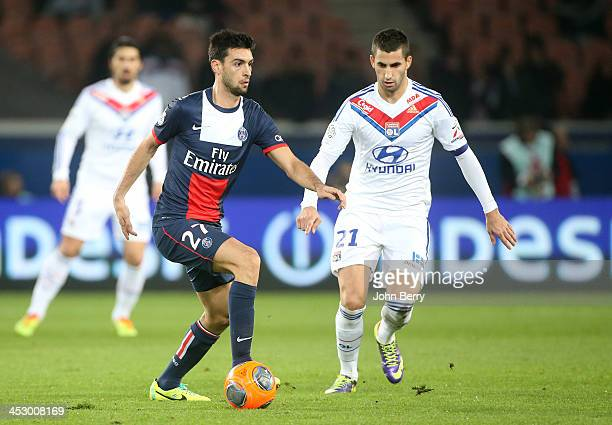 Javier Pastore of PSG and Maxime Gonalons of Lyon in action during the French Ligue 1 match between Paris SaintGermain FC and Olympique Lyonnais at...