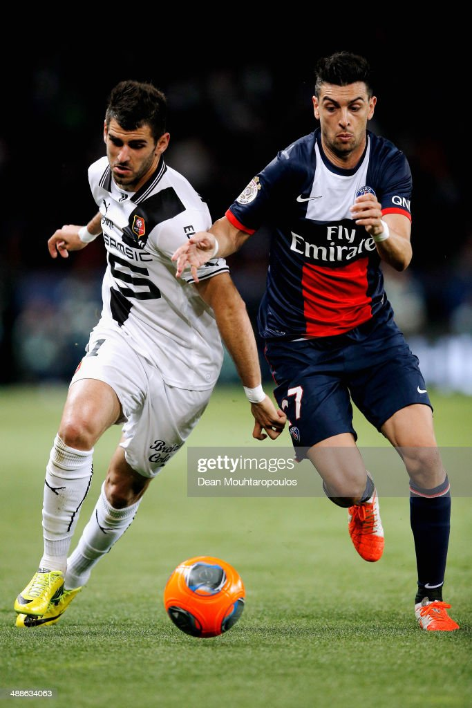 <a gi-track='captionPersonalityLinkClicked' href=/galleries/search?phrase=Javier+Pastore&family=editorial&specificpeople=5857872 ng-click='$event.stopPropagation()'>Javier Pastore</a> of PSG and Nelson Miguel Castro Oliveira of Rennes battle for the ball during the Ligue 1 match between Paris Saint-Germain FC and Stade Rennais FC at Parc des Princes on May 7, 2014 in Paris, France.