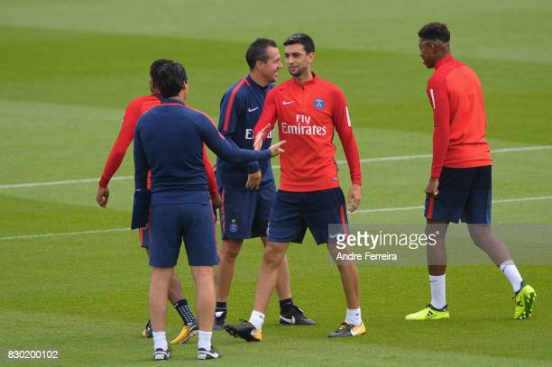 Javier Pastore of PSG and Unai Emery coach of PSG during the training session of Paris Saint Germain on August 11 2017 in Paris France