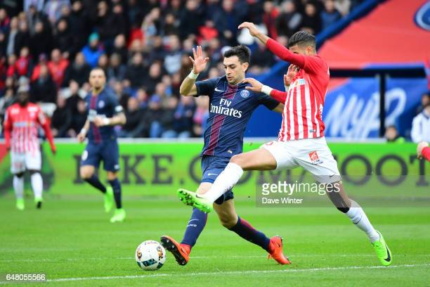 Javier Pastore of PSG and Youssef Ait Bennasser of Nancy during the French Ligue 1 match between Paris Saint Germain and Nancy at Parc des Princes on...