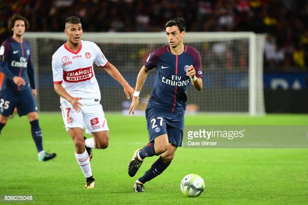 Javier Pastore of PSG and Zinedine Machach of Toulouse during the Ligue 1 match between Paris Saint Germain and Toulouse at Parc des Princes on...