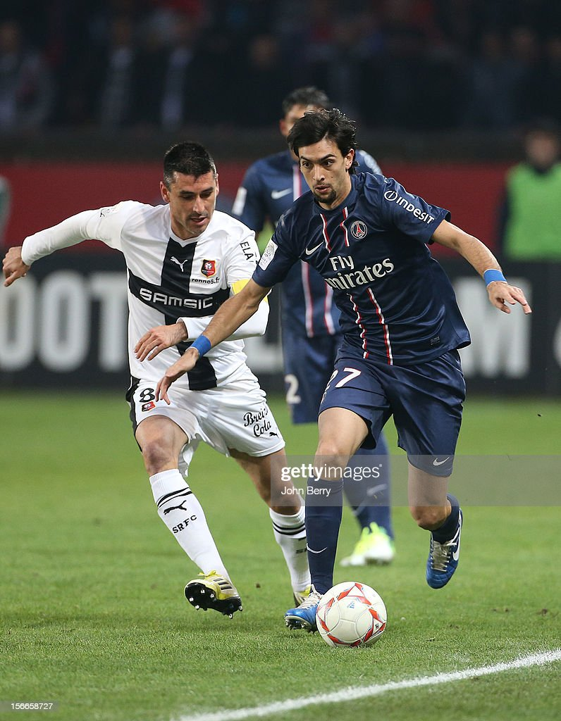 Javier Pastore of PSG dribbles Julien Feret of Rennes during the french Ligue 1 match between Paris Saint Germain FC and Stade Rennais FC at the Parc des Princes stadium on November 17, 2012 in Paris, France.