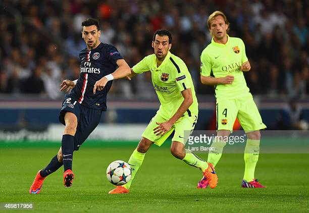 Javier Pastore of PSG is challenged by Sergio Busquets of Barcelona during the UEFA Champions League Quarter Final First Leg match between Paris...