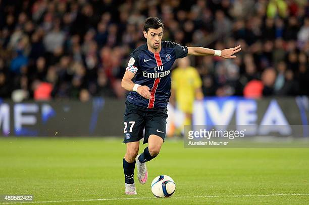 Javier Pastore of PSG runs with the ball during the Ligue 1 game between Paris SaintGermain and EA Guingamp at Parc des Princes on September 22 2015...