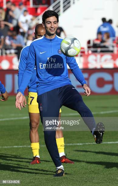 Javier Pastore of PSG warms up before the French Ligue 1 match between Dijon FCO and Paris Saint Germain at Stade Gaston Gerard on October 14 2017 in...