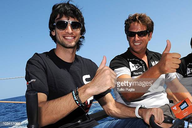 Javier Pastore player of US Citta di Palermo and skipper Gabriele Bruni gesture as they attend the unveiling of the Grand Soleil 42 Race ManLauria...