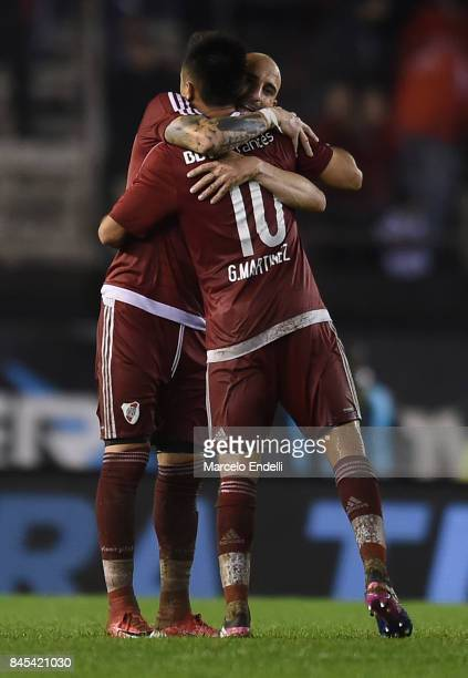 Javier Pinola and Gonzalo Martinez of River Plate celebrate after winning a match between River Plate and Banfield as part of Superliga 2017/18 at...
