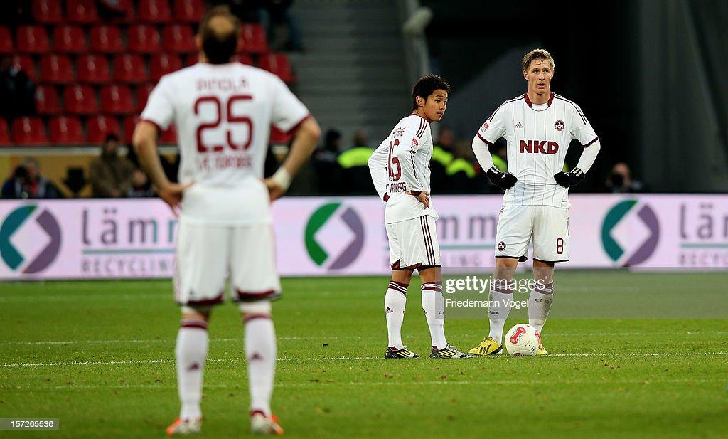 Javier Pinola Hiroshi Kiyotake and Sebastian Polter of Nuernberg look disappointed during the Bundesliga match between Bayer 04 Leverkusen and 1 FC...