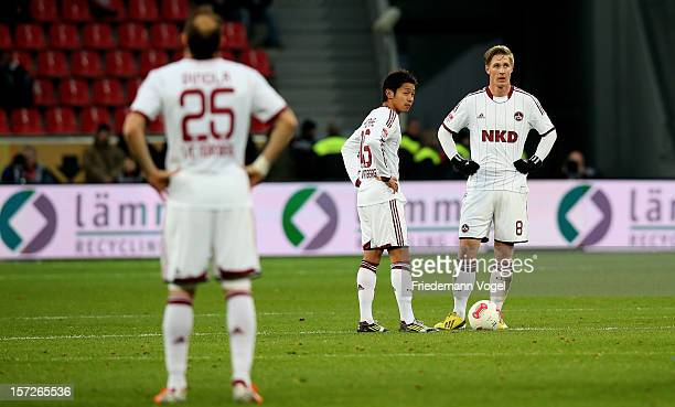 Javier Pinola Hiroshi Kiyotake and Sebastian Polter of Nuernberg look disappointed during the Bundesliga match between Bayer 04 Leverkusen and 1 FC...