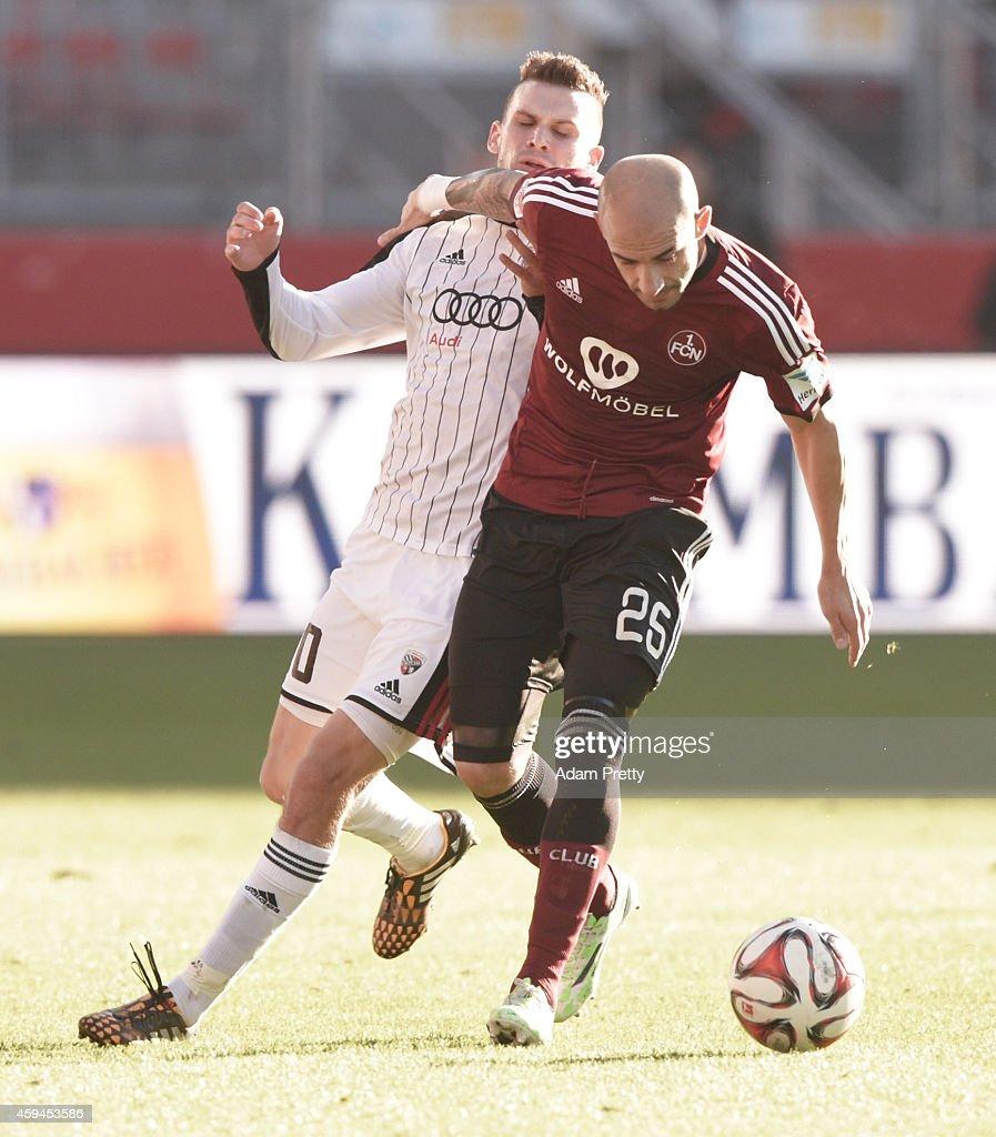 Javier Pinola of FC Nuernberg challenges Pascal Gross of FC Ingolstadt during the 2 Bundesliga match between FC Nuernberg and FC Ingolstadt at...