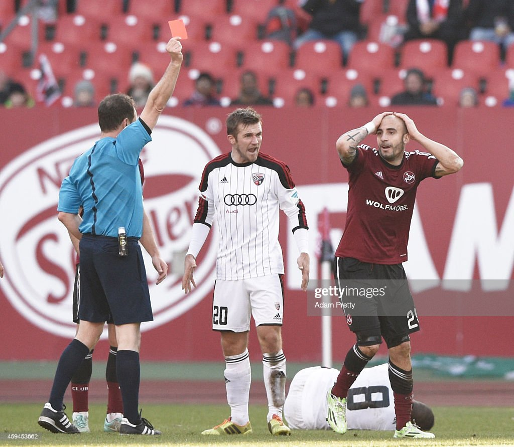 Javier Pinola of FC Nuernberg is shown a red card after fouling Bernardo De Oliveira of FC Ingolstadt during the 2 Bundesliga match between FC...